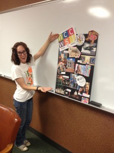 Laura Saucier with the poster she designed for the presentation.